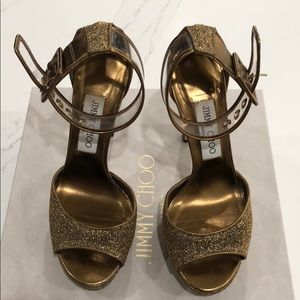 Gold jimmy choo mayner